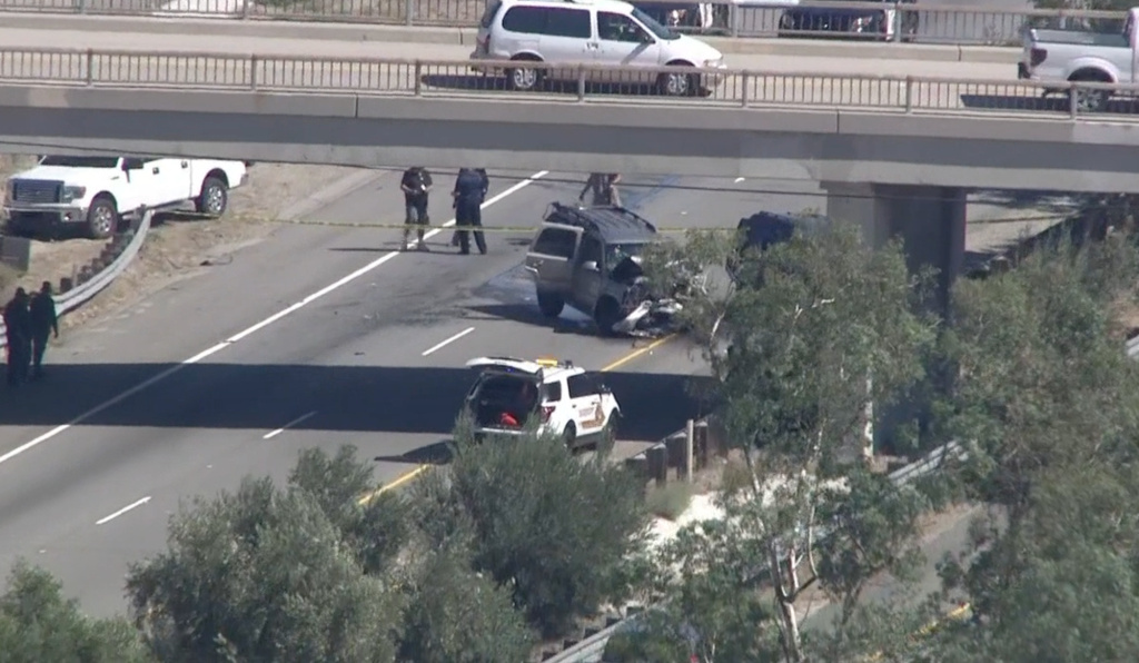 A San Bernardino County Sheriff's deputy shot from a helicopter at a car going the wrong way on the 215 Freeway, Friday, Sept. 18, 2015 NBC LA