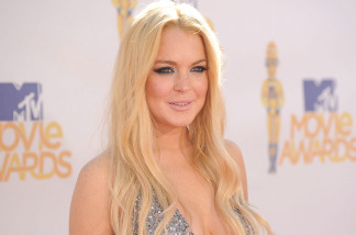 Actress Lindsay Lohan poses at the 2010 MTV Movie Awards on June 6, 2010 in Universal City, California.