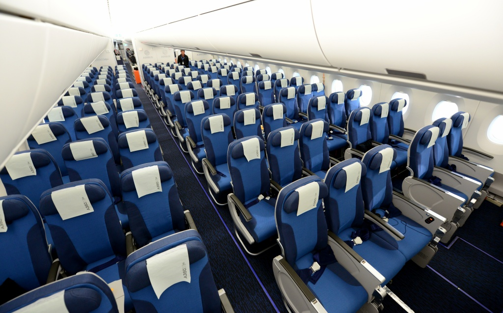 The interior of the economy class of the new Airbus A350 XWB is pictured during a presentation in Hamburg, northern Germany on April 07, 2014. European aircraft manufacturing company  Airbus presented the interior of its future A350 which - according to the company - will offer