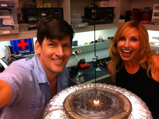 Off-Ramp host John Rabe, KPCC Chief Engineer Lance Harper's Tesla coil, and Mythbuster Kari Byron, in the KPCC engineering shop on Nicolai Tesla's 158th birthday.