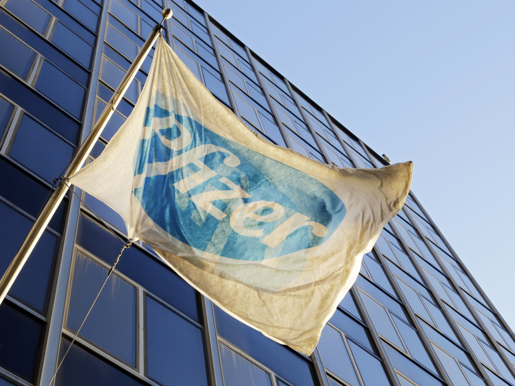 The Pfizer flag flies in front of its world headquarters in New York. Pfizer and Dublin-based Allergan will merge, creating the world's biggest drug-maker by sales.