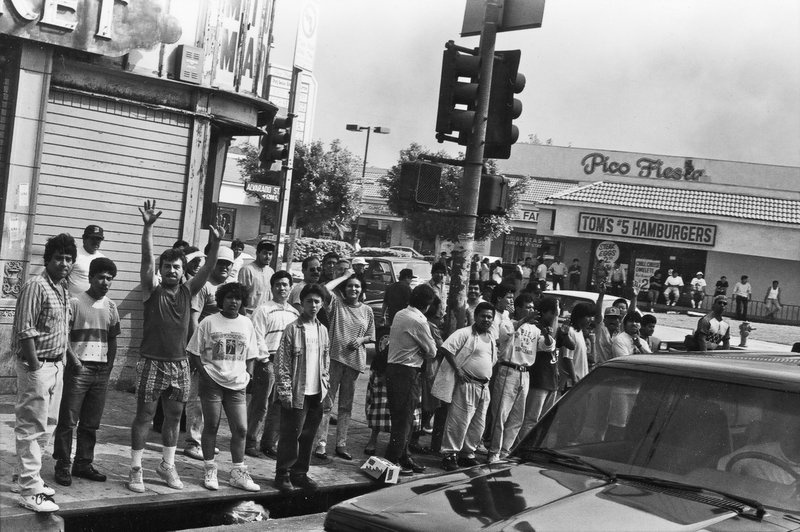 People gather in the Pico-Union neighborhood of Los Angeles during rioting following the acquittal of four police officers in the beating of Rodney King in 1992. The neighborhood looks similar today as it did 25 years ago. It's still more than 80 percent Latino, with lots of immigrant families from Mexico and Central America.