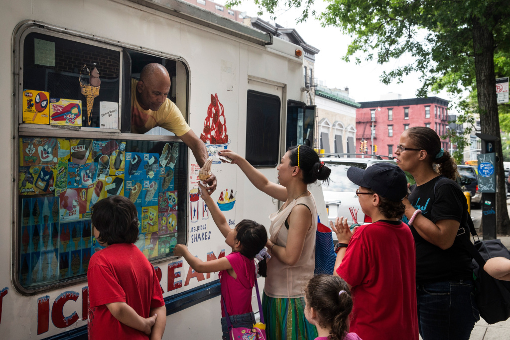 People wait in line for ice cream in the Lower East Side neighborhood of New York City.