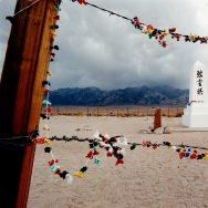Offerings hang on the barded wire fence surrounding the cemetery of the Manzanar War Relocation Center June 25, 2000 south of Independence, CA.