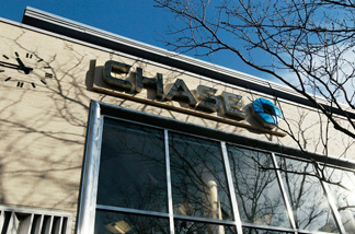 JPMorgan Chase admitted to overcharging more than 4,000 active-duty military personnel on their home loans and said it foreclosed in error on 14 of them. The company will send out $2 million worth of refunds to 4,000 active-duty customers who were affected.