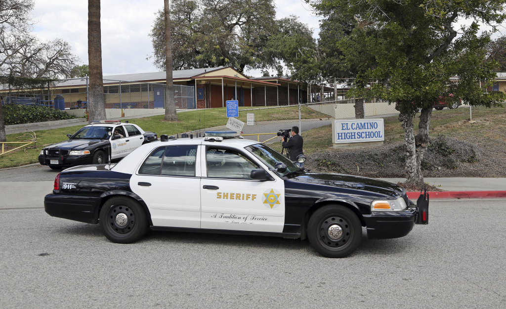 Los Angeles County Sheriff's patrol cars leave El Camino High School in Whittier, Calif., Wednesday, Feb. 21, 2018.