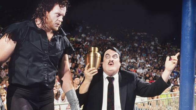 Pro wrestling manager Paul Bearer (R) with wrestler the Undertaker (L).