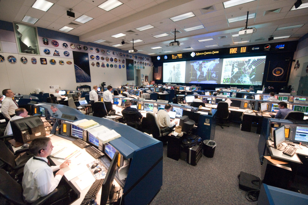 In this handout image provided by the National Aeronautics and Space Administration (NASA), Flight controllers on sit behind their consoles in shuttle flight control room (WFCR) at the Mission Control Center at Johnson Space Center before the launch of NASA space shuttle Atlantis July 08, 2011 in Houston, Texas.