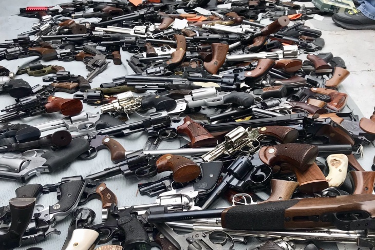 A photo released by LAPD shows a cache of over 1,000 firearms seized from a mansion in the Holmby Hills neighborhood of Los Angeles on Thursday, May 9, 2019.