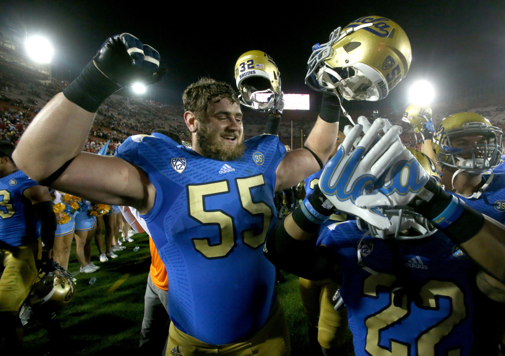 Ben Wysocki #55 of the UCLA Bruins celebrates with teammates after the game with the USC Trojans at Los Angeles Coliseum on November 30, 2013 in Los Angeles, California.  The Bruins won 35-14.