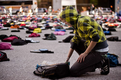 A student approaches a backpack that is part of a Send Silence Packing exhibit. The project is currently touring around the Southland.