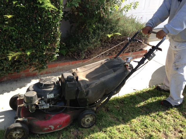 Jesus Cortez mows a customer's lawn in Orange County. He's hoping he can put his college education to use if he qualifies for immigration relief under the Obama administration's new immigration plan. He's earned a master's degree, but was too old to qualify for Deferred Action for Childhood Arrivals in 2012.