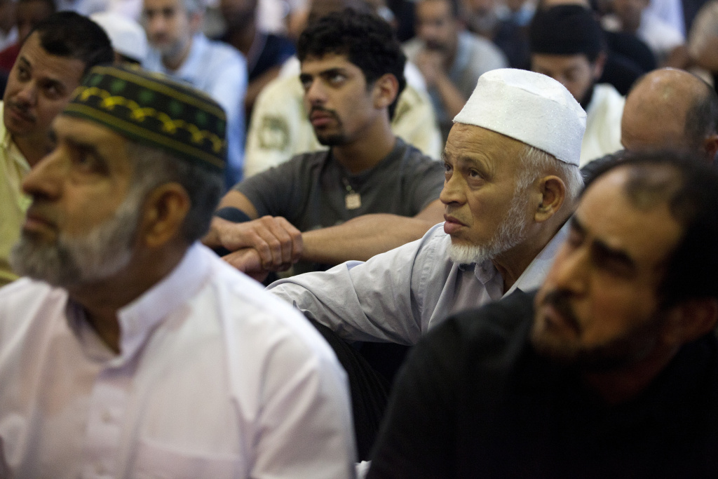 Abdul Rahman Mayet listens to a summon during Friday afternoon prayers at the King Fahad Mosque in Culver City.