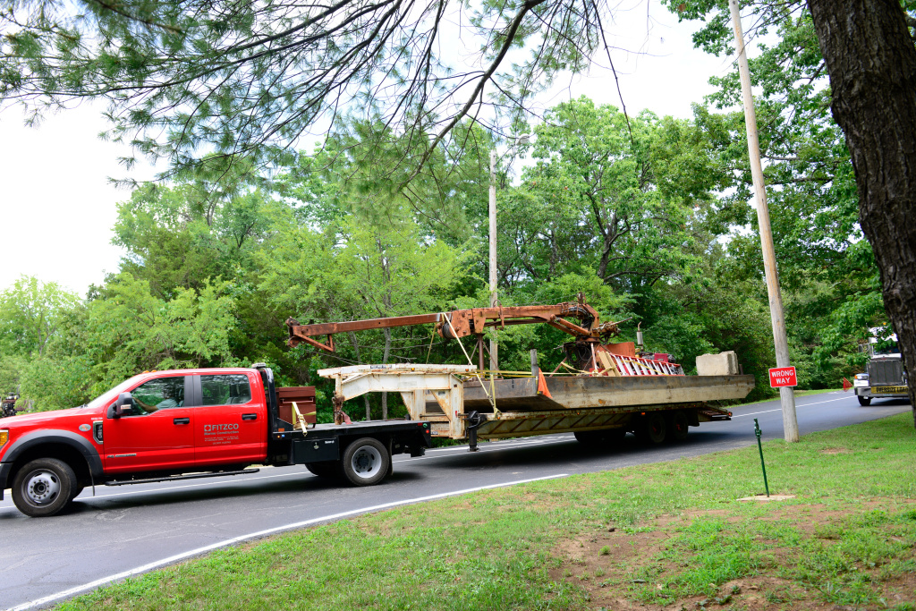 Salvage equipment to remove the capsized duck boat is transported to a staging area at Table Rock Lake near Branson, Mo. The U.S. Coast Guard oversaw the operation on Monday.