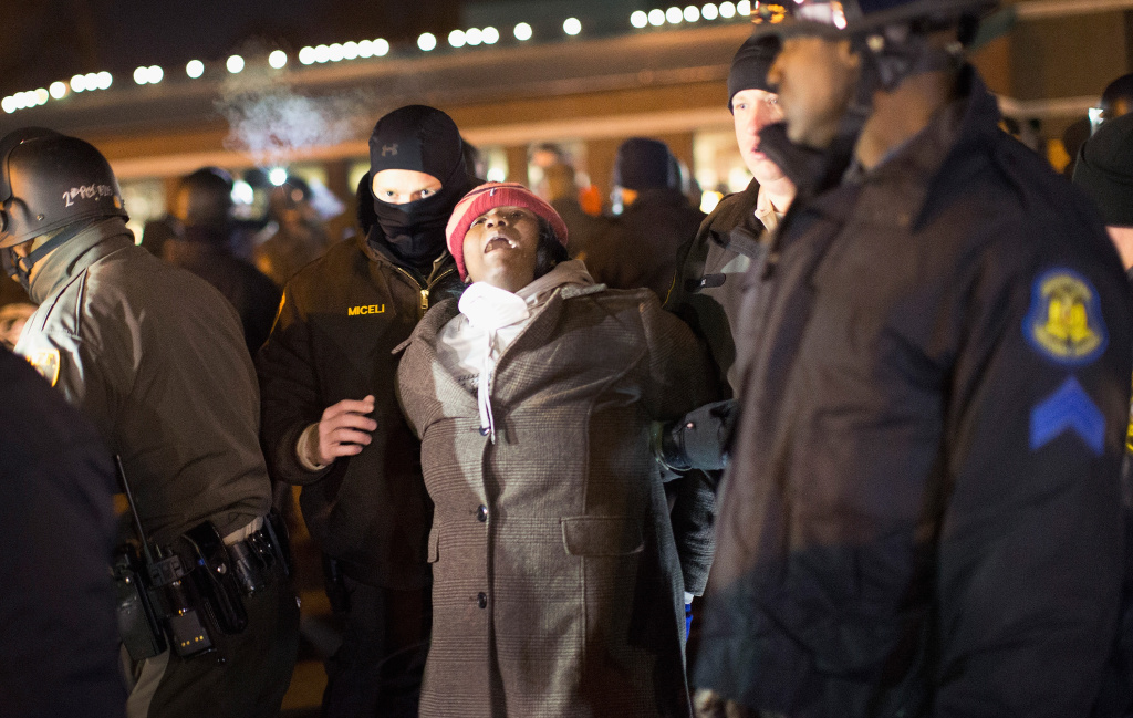 File: Police arrest a demonstrator protesting the shooting death of 18-year-old Michael Brown outside the police station on November 20, 2014 in Ferguson, Missouri. The FBI has sent nearly 100 additional agents to Ferguson, Missouri, to help law enforcement there as officials prepare for possible unrest