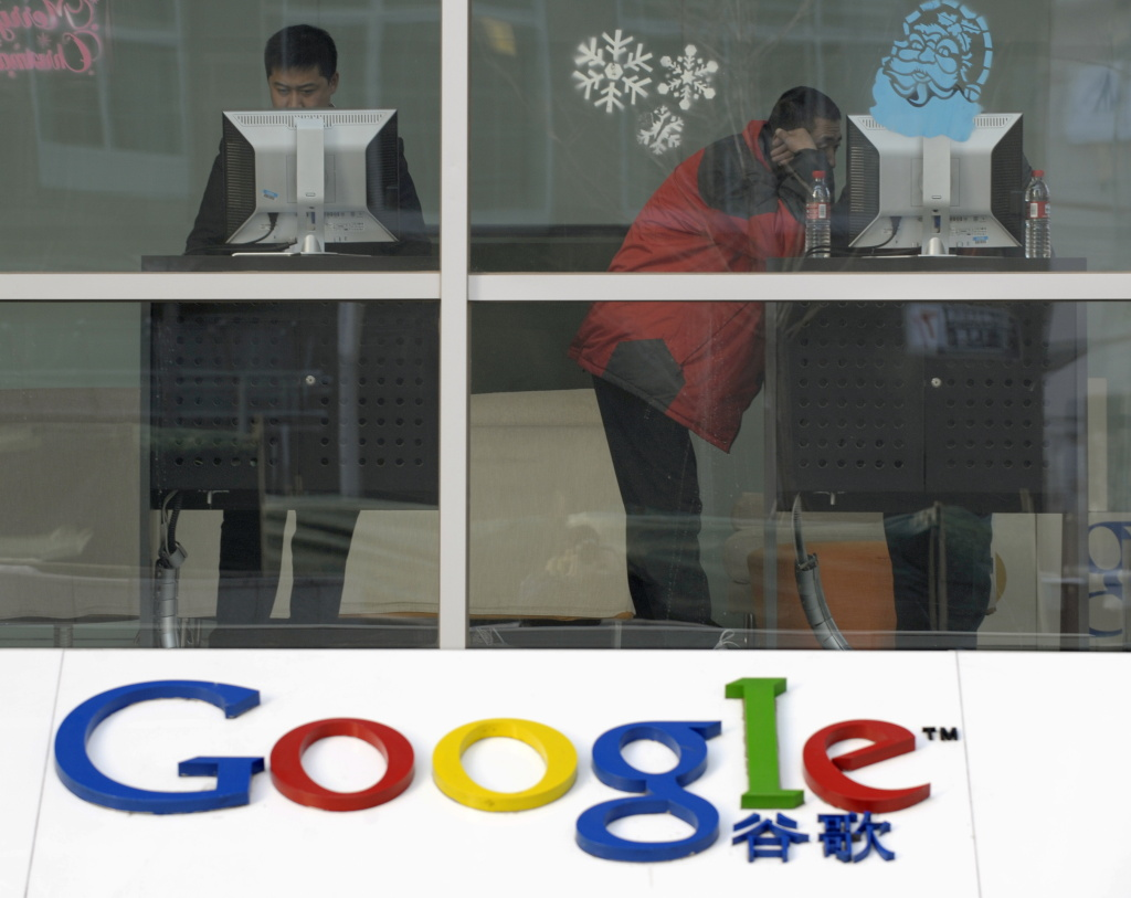 People use computers inside the Google China headquarters building in Beijing on January 14, 2010.