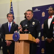 Los Angeles Mayor Eric Garcetti watches as police chief Charlie Beck addresses the media with rappers The Game (2/L) and Snoop Dogg (R) at LAPD headquarters on July 8, 2016.