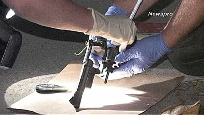 Police recover a revolver possibly used in a San Bernardino gunfight in which two men were killed, a woman gravely injured and another man shot in the foot.
