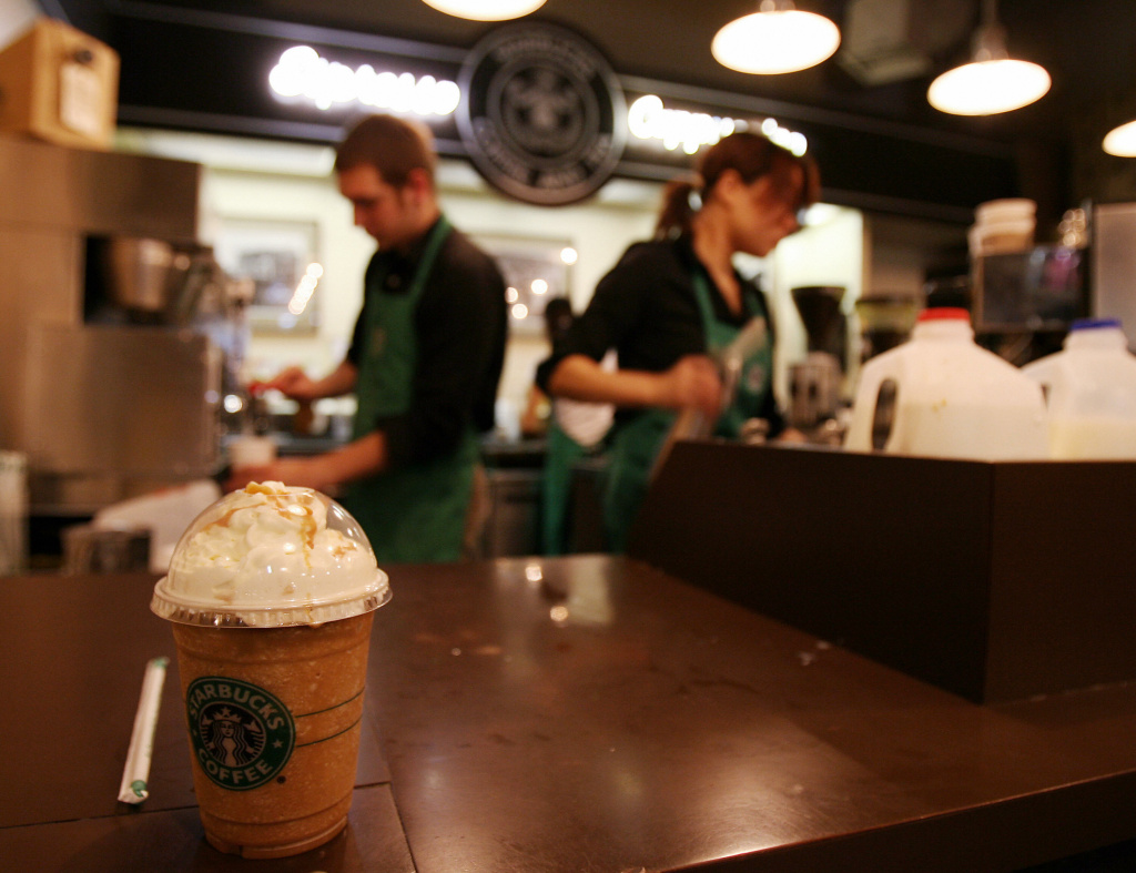 Employees prepare beverages in the first Starbucks coffee shop in Seattle.