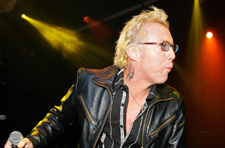 Warrant singer Jani Lane performs with Camp Freddy during the grand opening of the Empire Ballroom October 22, 2005 in Las Vegas, Nevada.