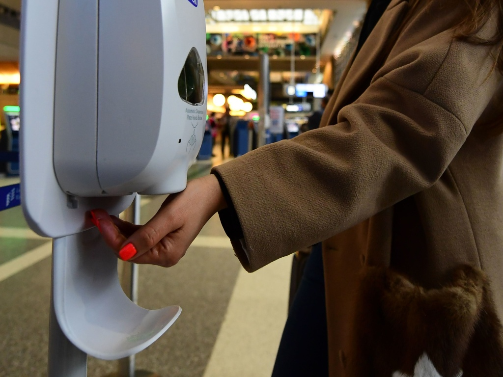 A woman uses hand sanitizer at Los Angeles International Airport on Thursday, the day before the start of the U.S. ban on travel from some European countries amid concern over the coronavirus.