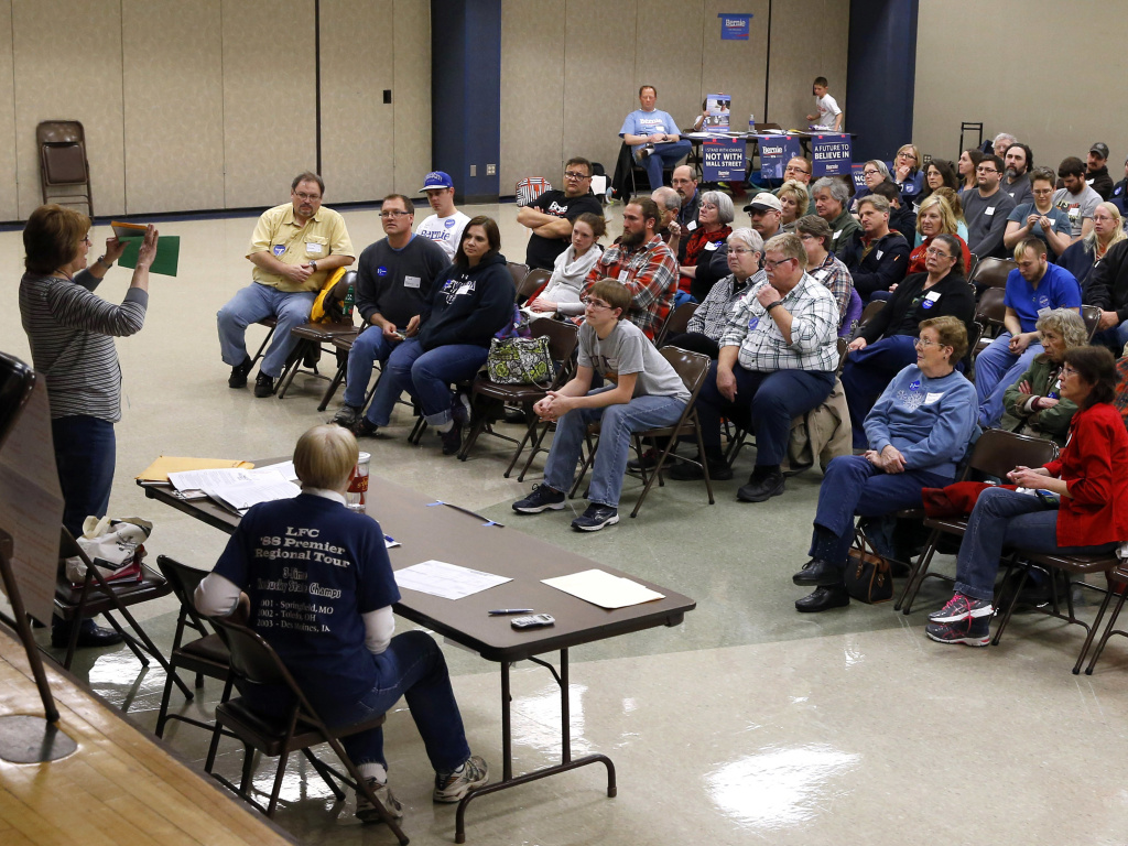Voters listen to instructions during a Democratic Party caucus in 2016. The party has been under pressure to make the process more accessible this year, but some activists remain frustrated.