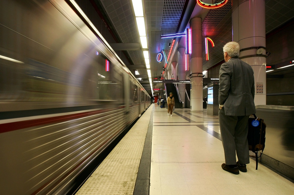 FILE PHOTO: A rider waits to board as a train arrives at the subway stop at Pershing Square on April 25, 2006 in Los Angeles. Metro is taking up new policing contracts aimed at improving safety for its train and bus lines.