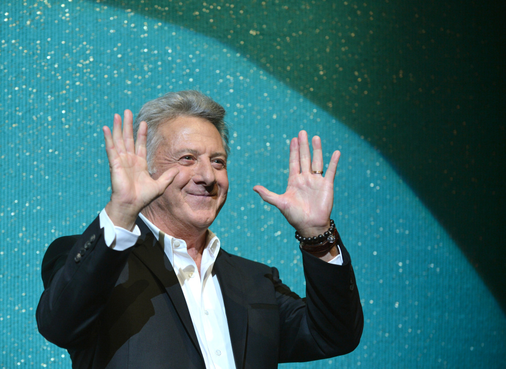 US actor and director Dustin Hoffman waves to the audience at the Japan premiere of 'Quartet' in Tokyo on April 8, 2013.