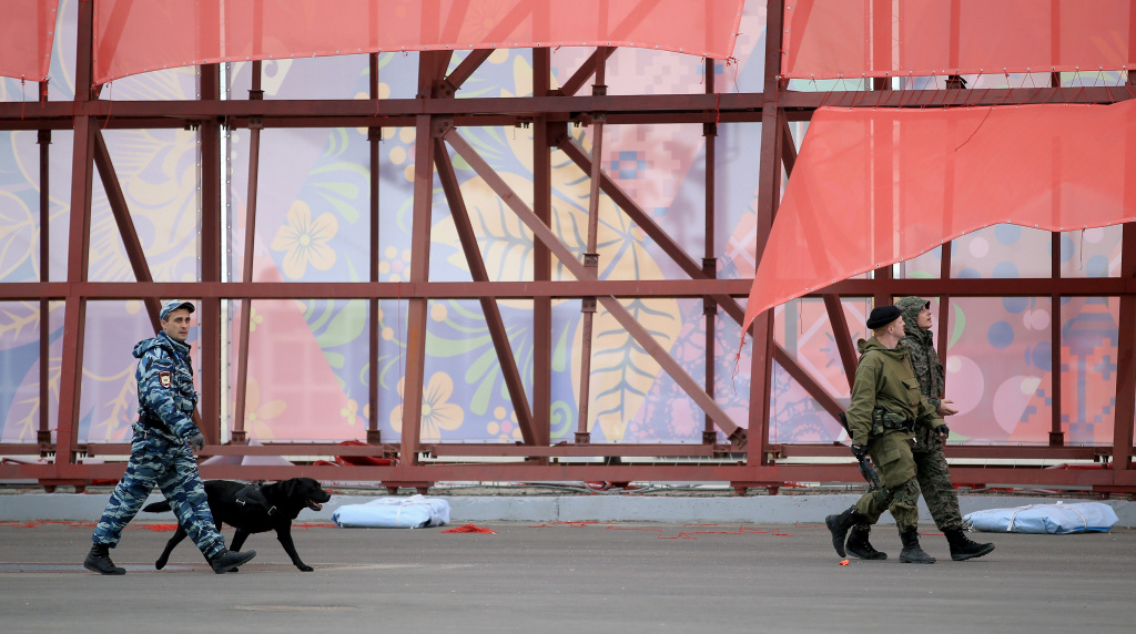 Security with dogs patrol around the Sochi 2014 Winter Olympic Park in the Costal Cluster on January 28, 2014 in Sochi, Russia.