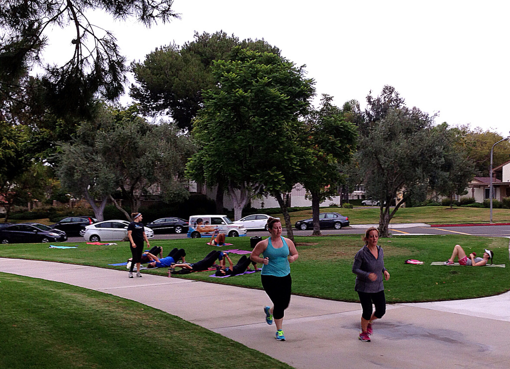 Irvine residents exercise at the end of the work day by one of the city's parks.