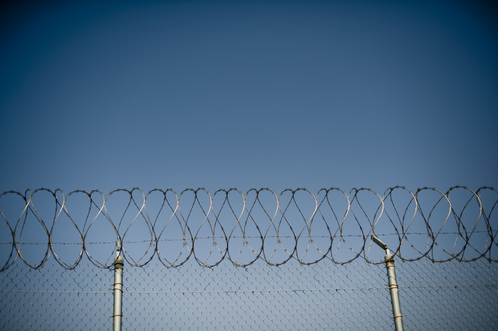 File: A fence is seen at a California prison. A former guard at a state prison in Southern California has been pleaded no contest to smuggling drugs and other contraband to fellow gang members behind bars.