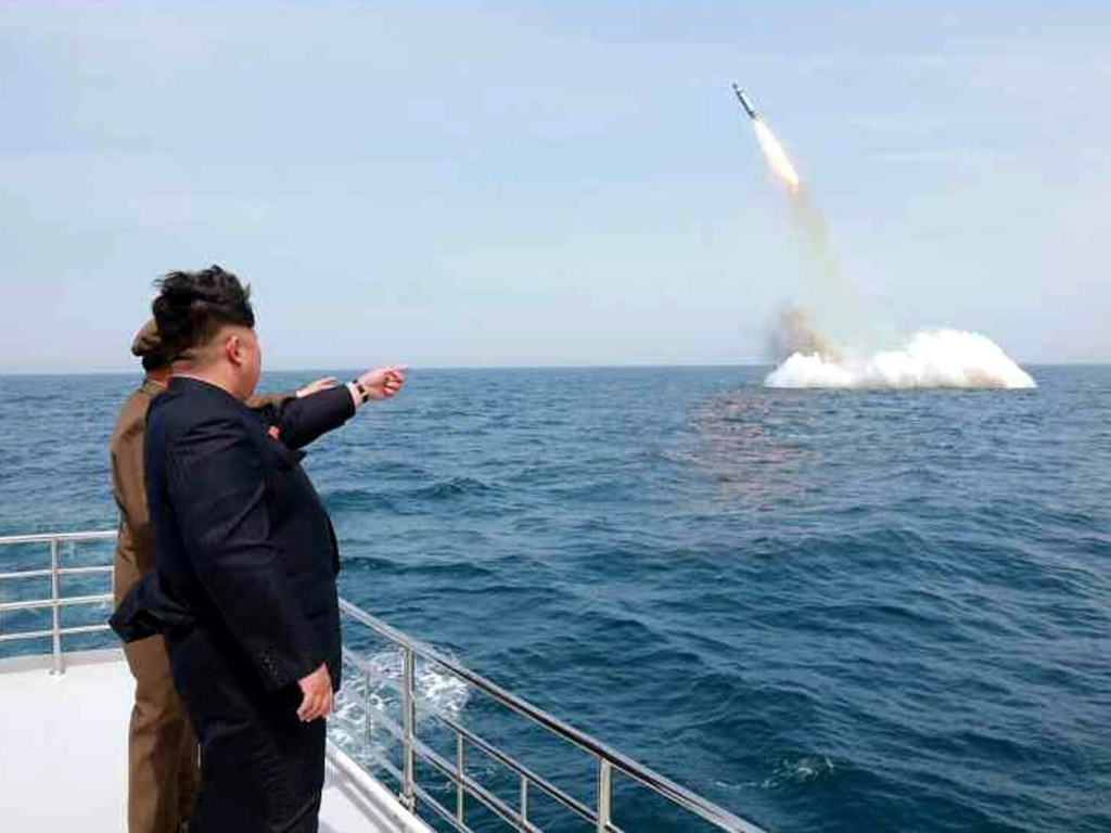 An image obtained by Yonhap News Agency showing North Korean leader Kim Jong Un pointing at a ballistic missile believed to have been launched from underwater near Sinpo, on the northeast coast of North Korean, on Saturday.