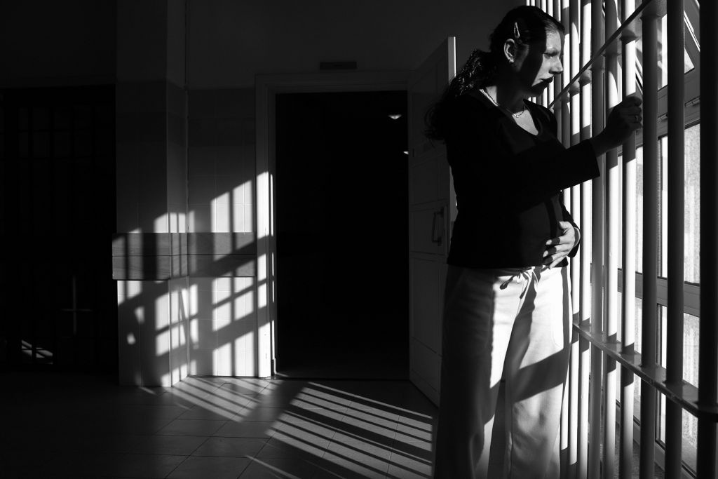 33 year-old and six month pregnant Spanish Rosa Maria Minguez Fito looks out from a window, inside the female prison of Santa Cruz do Bispo 23 November 2007, in Porto.