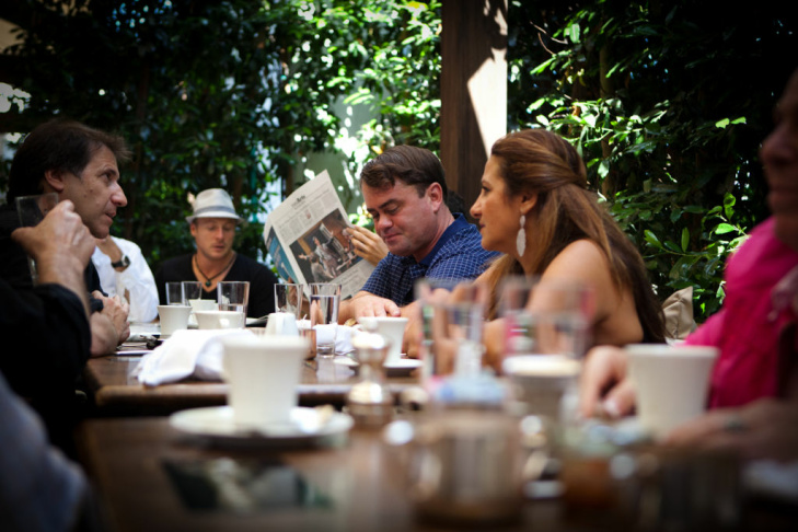 West Hollywood, CA - July 10, 2012: Dawn Bowery (center), a photographer and member of the group Brits in LA has breakfast with other members at Cecconi's Restaurant on Melrose Avenue - as part of an ongoing bi-weekly breakfast club.