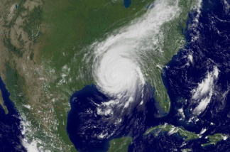 In this satellite image from NOAA, Hurricane Katrina is seen at 1:15 PM (EST) August 29, 2005 over the Gulf Coast. Katrina, then a Category 2 strom with 105 mph winds, made landfall close to Empire, Louisiana at about 6:00 AM (CDT).