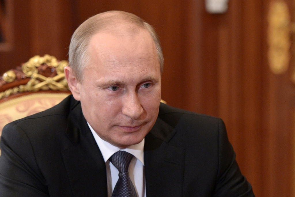 Russia's President Vladimir Putin attends a meeting in the Kremlin in Moscow, on June 19, 2014.