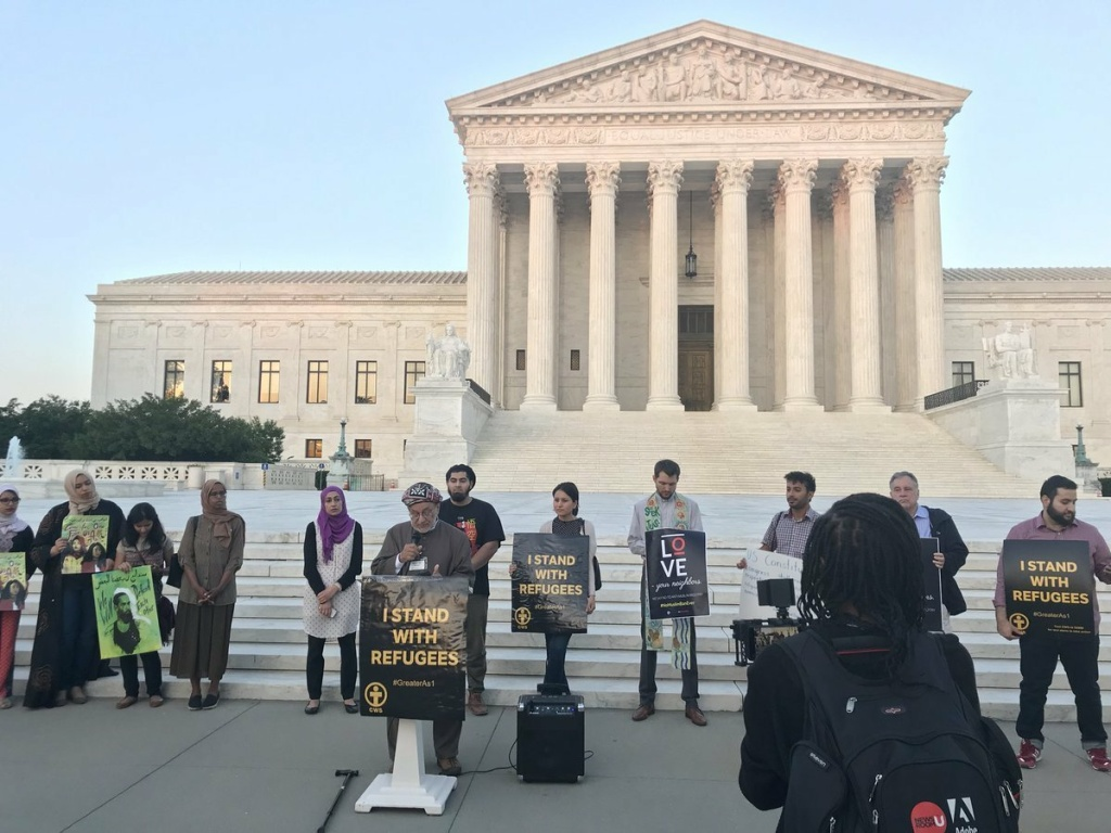 Members of MPower Change and allies stand in solidarity for refugee rights on the steps of the Supreme Court before breaking fast.