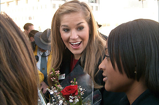 Mary McCluggage, 2007 Rose Queen, with her court, distributing roses to Gold Line passengers.