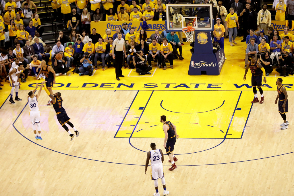 OAKLAND, CA - JUNE 02:  Stephen Curry #30 of the Golden State Warriors shoots a three pointer over Kyrie Irving #2 of the Cleveland Cavaliers in Game 1 of the 2016 NBA Finals at ORACLE Arena on June 2, 2016 in Oakland, California. NOTE TO USER: User expressly acknowledges and agrees that, by downloading and or using this photograph, User is consenting to the terms and conditions of the Getty Images License Agreement.  (Photo by Ezra Shaw/Getty Images)