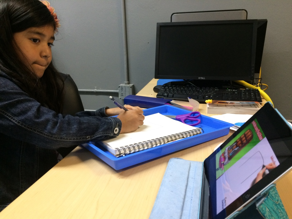 FILE: Cristina Zaldivar, 9, uses an iPad to learn to draw at the Bell Technology Center during a computer class.