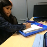 Cristina Zaldivar, 9, uses an iPad to learn to draw at the Bell Technology Center during a computer class.
