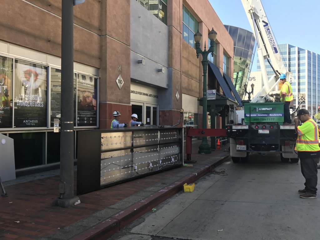Workers preparing to install Antaeus' marquee in September 2017.