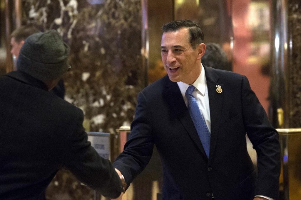 In this file photo taken Dec. 14, 2016, US Representative Darrell Issa arrives for a meeting with US President-elect Donald Trump at Trump Tower in New York. The Democratic Party is targeting Issa, who represents parts of Orange and San Diego counties, for defeat in the 2018 election.