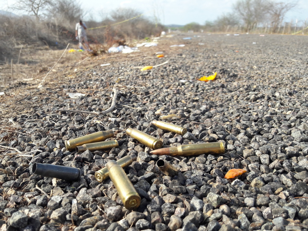 Spent bullet casings litter a road after authorities reported a gun battle outside Mazatlan, Mexico, in July 2017, a year marked by the highest homicides in at least decades.