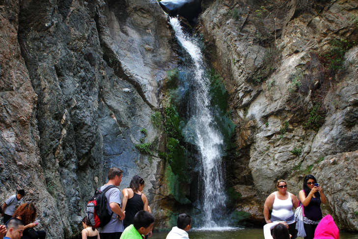 Children play under the waterfalls in Eaton Canyon Park on Wednesday afternoon, March 27.
