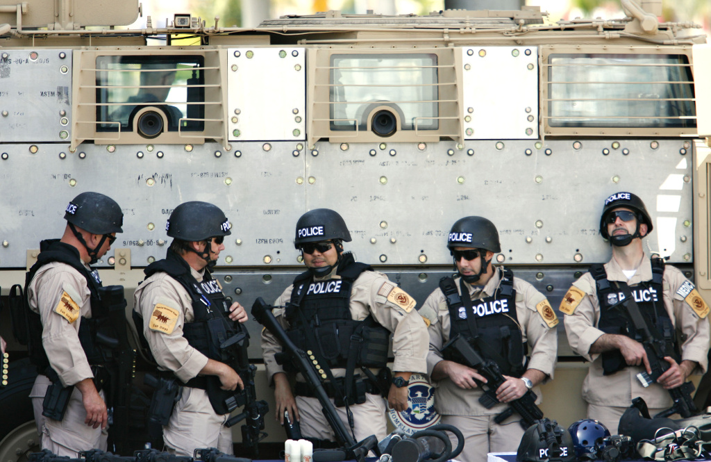 Members of the Immigration and Customs Enforcement at the Otay Mesa Port of Entry during a visit by former Department of Homeland Security Chief Janet Napolitano.