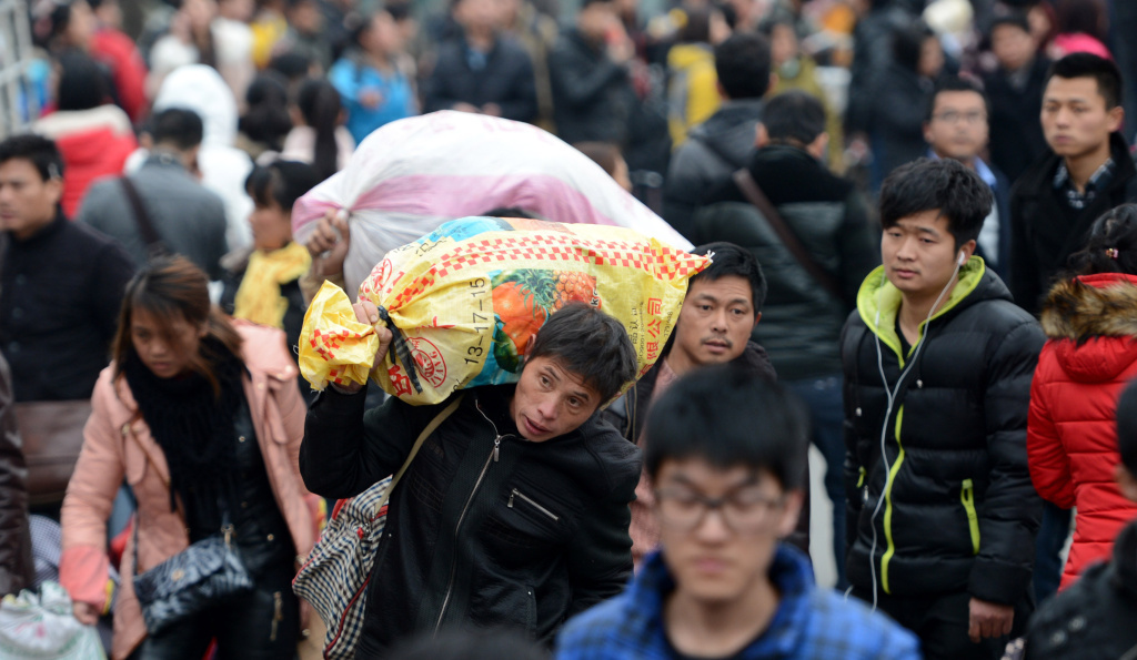 Passengers go to the Nanchang railway station in eastern China in February 2014, at the end of the Chinese New Year holiday. In the past, it was often the only time of year that migrant workers were able to return home. Now, economic pressures on factories in coastal China have led to a reversal of a decades-long migration of workers from inland to the coast.