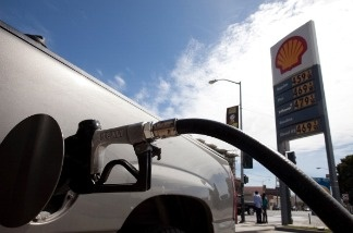 A sign showing the price for gasoline is displayed at a Shell gas station on April 27, 2011 in San Francisco, California.