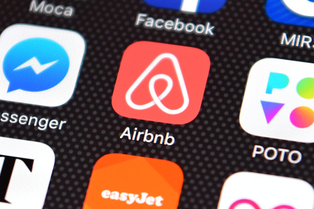 The Airbnb app logo is displayed on an iPhone on August 3, 2016.