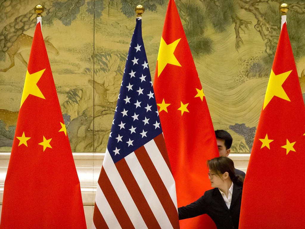 U.S. and Chinese flags before the opening session of 2019  trade negotiations between U.S. and Chinese trade representatives in Beijing. On Thursday, China passed  a sweeping new law designed to counter numerous sanctions the United States and the European Union have imposed on Chinese officials and major Chinese companies.